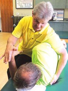 Roger Kraig applies MST to a client with shoulder impingements.