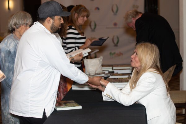 Mimi Kirk compliments Chef Erick of The S Rancho Mirage on mastering her raw vegan recipes