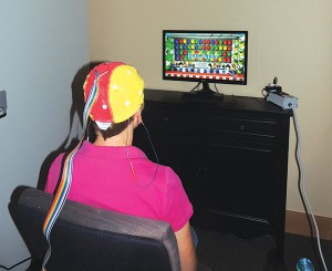 A cap with sensors reads brain activity which translates to progress with the visual and audio computer game.