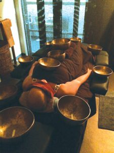 Shay practiced the healing therapy of Tibetan bowls.