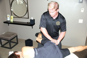 Michael Butler uses ART on a client with hip dysfunction.