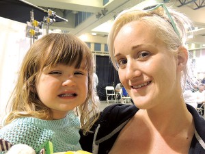 Penelope of Desert Hot Springs (with mom Bridgette) smiles with her new cavity-filled teeth