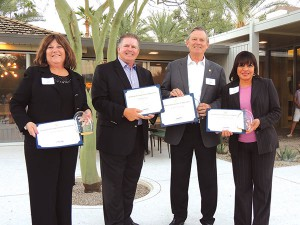 Vita Willett, Gary Honts, Aubrey Serfling and Carolyn Caldwell display proclamations honoring their institution's contributions to CV Volunteers in Medicine